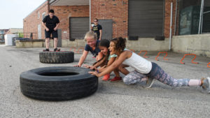 Kids working out with heavy tires